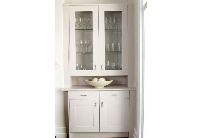 Bespoke furniture by Anthony Mullan furniture. White dresser cabinet designed for either side of fireplace, Shaker style, glass doors.