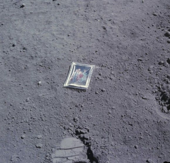 This photograph was left on the moon by astronaut Charlie Duke. In the picture are Charlie and his wife and children, sitting on a bench in summertime. Presumably it still lies there today, along with Duke's boot print.