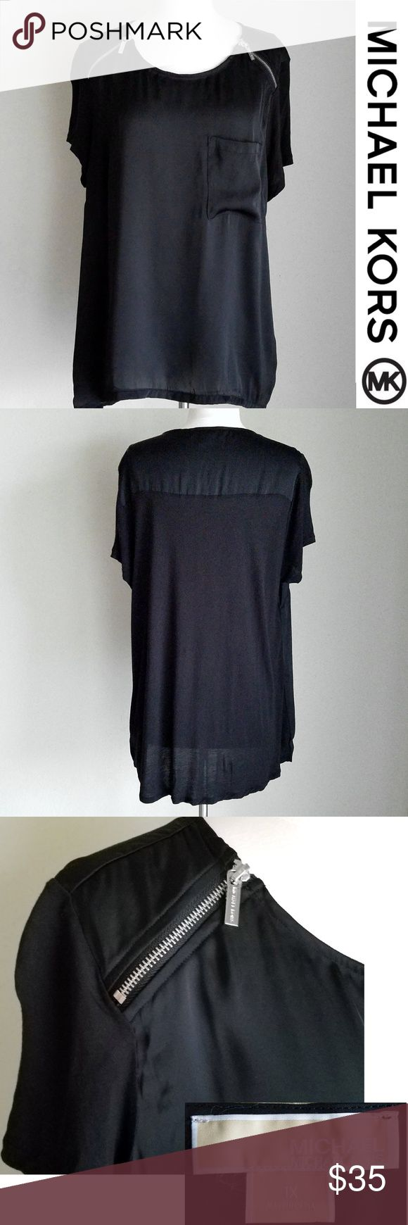 """Michael Kors Black Silky & Knit Zipper Top- Plus Front and top back are silky material. Sleeves and bottom back are thin knit material. Silver Michael Kors name zippers on shoulders. Slight high-low hem. Short sleeve. Machine wash, Line dry. Front- 100% rayon, Back- 100% polyester  Gently used condition (very slight wear from washing)  Plus size 1X. Length (shoulder to bottom- longer in back)- 27.5""""-30"""", Bust- 44"""", Waist- 44"""", Hip- 46"""" Michael Kors Tops Blouses"""