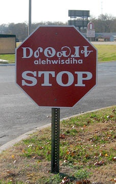 Stop sign in Cherokee syllabary and English in Tahlequah