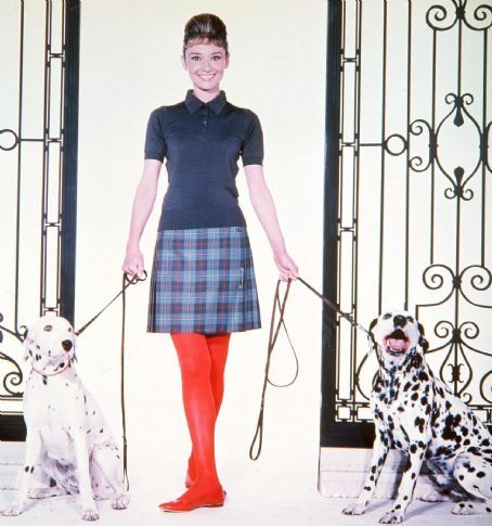 Audrey Hepburn with dalmatians, red tights and red ballet flats.