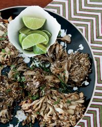 "Grilled Hen-of-the-Woods Mushrooms with Sesame | ""Hen-of-the-woods are often shredded and sautéed, but when you cook them whole, they become crispy outside and meaty and moist inside,"" says Jean-Georges Vongerichten of his preferred method of preparing the coral-like mushroom."