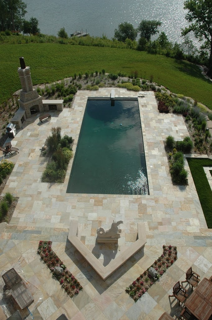 Carved Stone Creations provided the Serenghetti Gold Quartzite tile, seahorse statue, and granite trim for the outdoor fireplace.  The natural color variance of the quartzite tile gives the pool deck a beautiful and subtly colored look that concrete or ceramic tile just can't match.  Click on the image to see more pictures from this project.