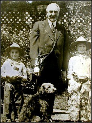 Move over, Secret Service. Two brave cowboys pose with Warren G. Harding and his pup, Laddie boy.