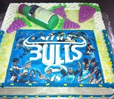 Blue Bulls themed rugby cake and Wine Bottle