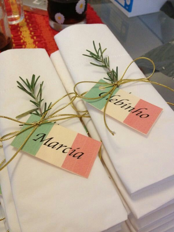 No name tags, but Tuscan colored napkins, wrapped with bakers twine and a sprig of rosemary