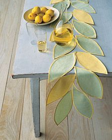 easy to make table runner  Interesting way to dress up a table.  This would be even easier if each leaf was finished with a rolled hem on a serger.  I will have to try this and have some books of sample fabrics that I can use and use up. Gotta start using my stash.