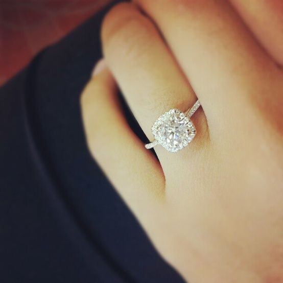 Cushion cut with thin band and small halo....Gorgeous!! The small diamonds in the band and halo are beautiful. I also love that there is no visible gap between the center stone and the halo like you sometimes see. Also, it's great that the halo is really thin. Can I have this?