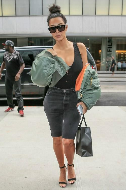 Kim Kardashian wearing Celine Cl 41756s Zz Top Sunglasses, Manolo Blahnik Suede Chaos Sandals and Vetements Mini Hooded Nylon Bomber Jacket