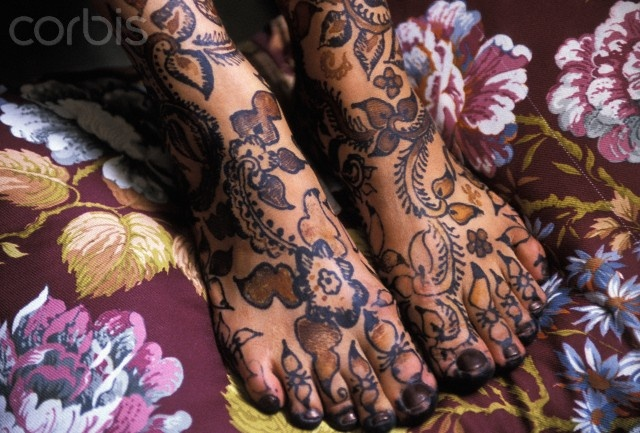 Africa | Close-up of woman's feet with henna tattoo.  Essaouira, Morocco | © Axiom Photographic