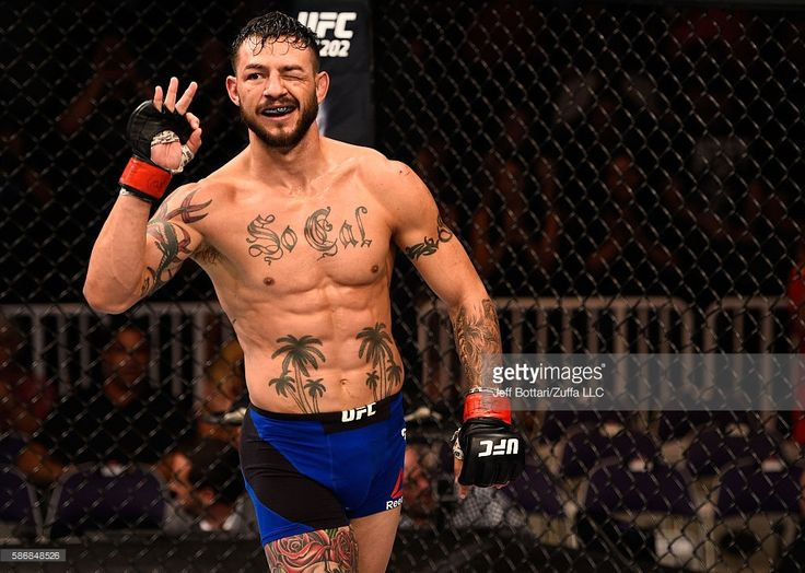 Cub Swanson raises his hand after facing Tatsuya Kawajiri of Japan in their featherweight bout during the UFC Fight Night event at Vivint Smart Home Arena on August 6, 2016 in Salt Lake City, Utah.