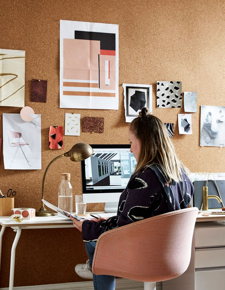 Lauren at her desk surrounded by materials and inspiration. Please take note of that corkboard wall! Photo – Caitlin Mills.