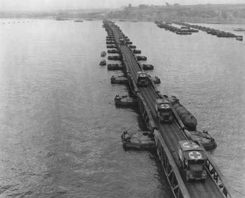 Ambulances on a floating pier of the Mulberry artificial harbor near Arromanches, France, during Operation Overlord, 6 June 1944 #DDAY