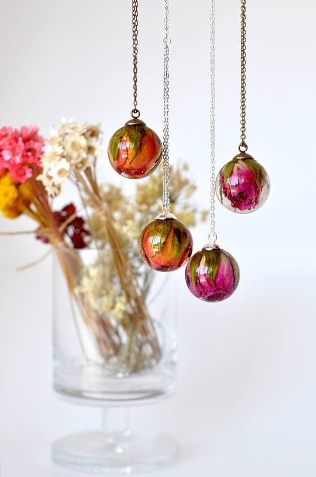 Jewelry designer Paula Schiau (of Resity) creates necklaces with whole flowers preserved in either resin or encased in glass pendants that look like they're straight out of a fairy tale.