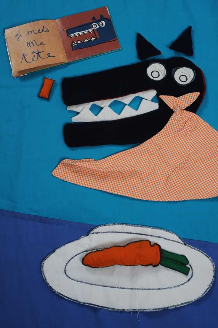 Ce tapis, créé à partir d'étoffes de couleurs gaies, le loup du livre d'Olivier Douzou est reconstitué avec des éléments mobiles dévoilés au fur et à mesure que l'animateur lit l'histoire : son nez, ses yeux, ses oreilles, ses dents, etc...