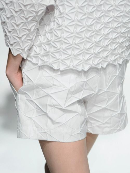 Fabric Manipulation - pleated shorts & top with geometric patterns + texture; fashion detail // Issey Miyake Spring 2015. geometric, structure, shapes, fashion, designer, inspiration, fashion design