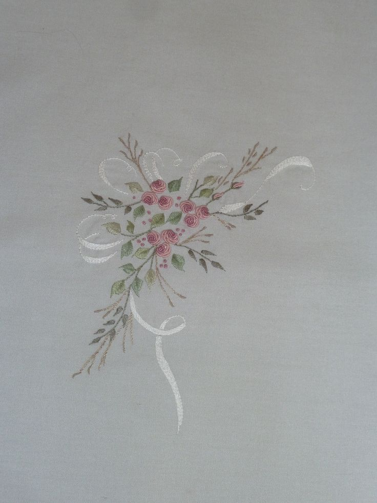 Spray of pink flowers with white ribbon