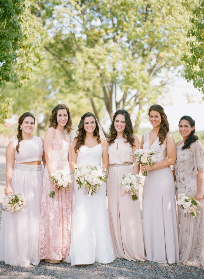 Neutral and blush mix + match bridesmaid dresses: http://www.stylemepretty.com/california-weddings/geyserville-california/2015/11/23/chic-rustic-winery-wedding-in-california/ | Photography: Silvana DiFranco - http://silvanadifranco.com/