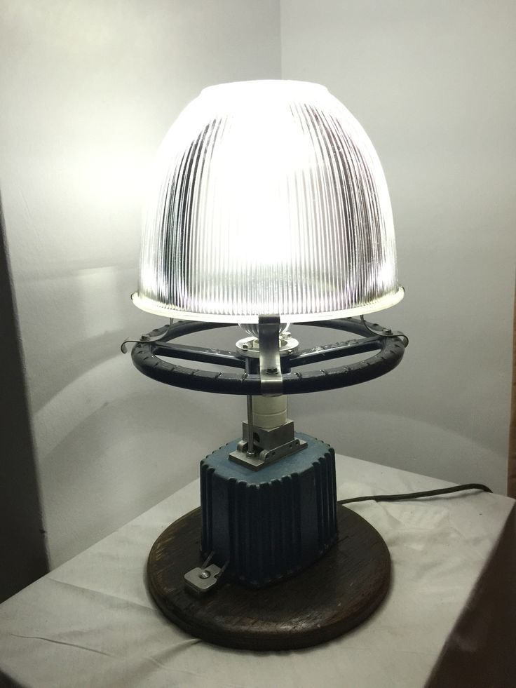 Vintage Industrial lamp made from all recycled materials. The lampshade was the reflector from a factory light as was the base.