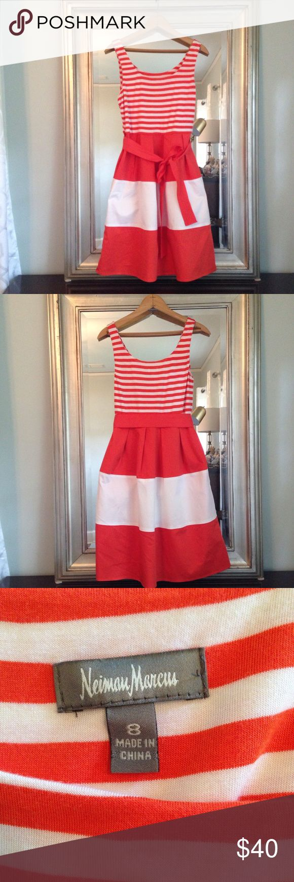 Orange and White Striped Neiman Marcus Dress This Neiman Marcus dress has been gently used but shows little wear. It has a side zipper and pockets. It is very comfortable and looks great dressed up or dressed down. Neiman Marcus Dresses Midi