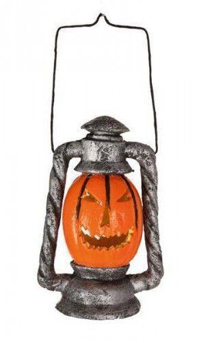 Oranje pompoen lantaarn met licht