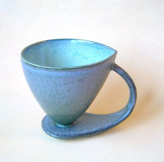 Jos van Alphen's very elegant coffeemug. I have this one in off-white,with black glazing on the inside. Check him out. Great stuff.