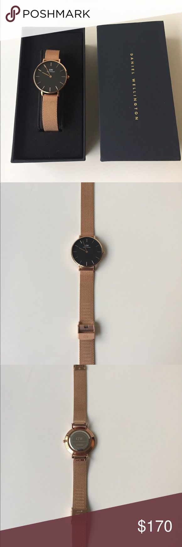 Daniel Wellington Classic Petite Melrose Daniel Wellington Classic Petite 32MM in Rose Gold. Worn a couple of times with light scratch on the back face of the watch. Still in excellent condition. Comes with a brand new classic petite reading black croc strap made from genuine Italian leather. Strap Width 14MM link color is rose gold. Everything comes in original box and tool to adjust & change straps. Daniel Wellington Accessories Watches