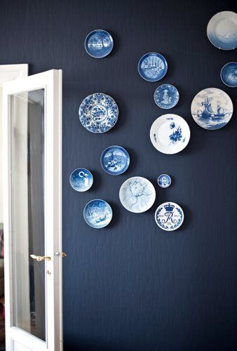 Royal Copenhagen. these look so fabulous hung against the indigo blue wall.