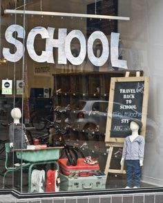 Back to School Window Display--we have two old desks, suitcases, an old chalkboard, and maps!