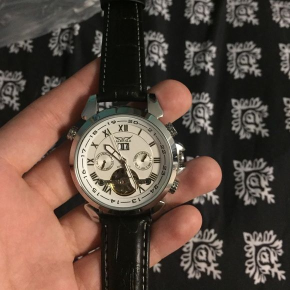 Jaguar Men's Watch Jaguar watch in great condition! It has black genuine leather straps, is stainless steel, and water resistant! Jaguar Accessories Watches
