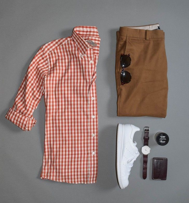 Menswear inspiration: gingham button up shirt, cognac colored pants, white sneakers and brown leather accessories