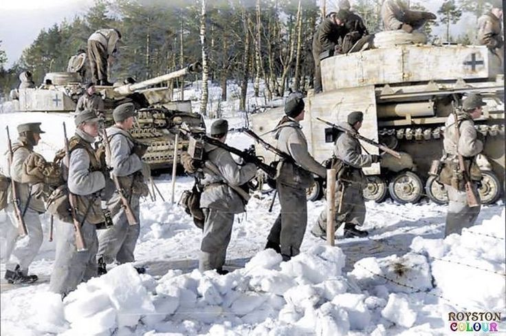 Infantry soldiers with several Panzer 4 Ausf H tanks operating inside Russia during 1943.