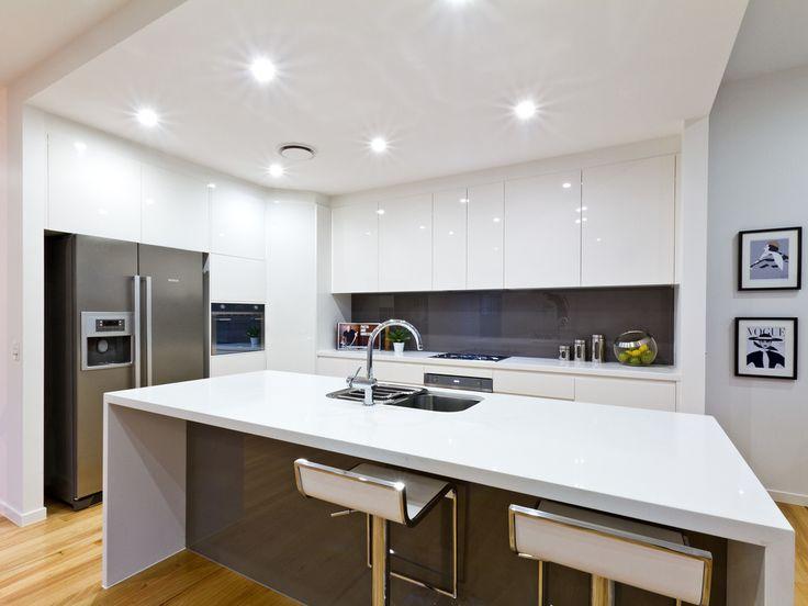 A kalka kitchen. 2Pac cabinetry, colourback glass splashback, Northern Beech timber flooring. Small lot home, Alderley, Brisbane