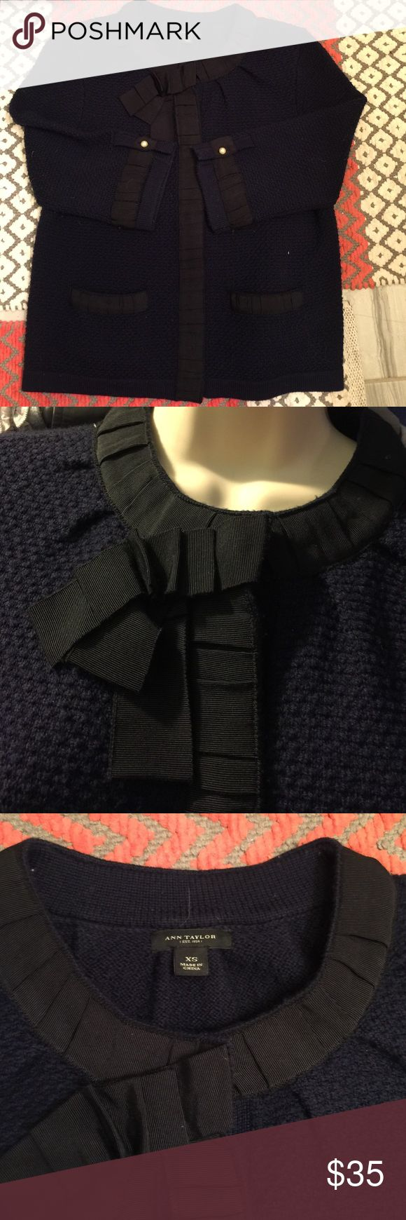 "Navy blue Cardigan w 1"" Ribbon Trim Ann Taylor Navy cardigan w heavy hidden snaps behind ruched ribbon trim. Hidden pockets on front top ribbon trimmed. 3/4 sleeves w ribbon trim & pearl button. Ann Taylor Sweaters Cardigans"