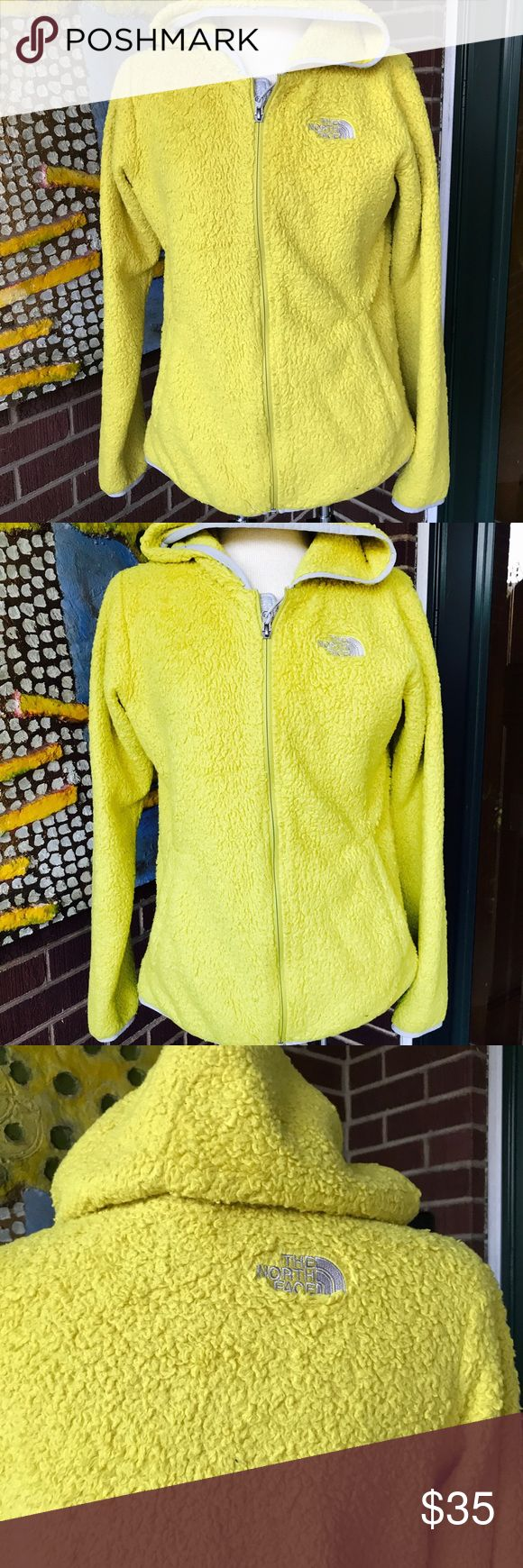 North Face Women's Yellow Hooded Jacket This hooded jacket from North Face in yellow is so beautiful. Lovely light gray trimming with side pockets. Zip up closure. It has soft material. No signs of wear and tear but this jacket is so well-loved. North Face Jackets & Coats