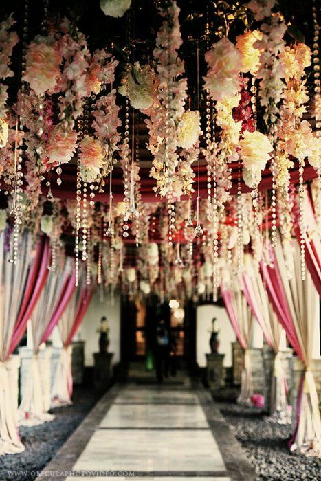 flowers and crystals hanging from the entrance to the reception