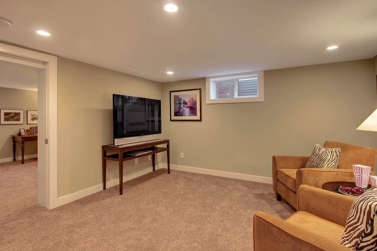 Heaton Dainard flips another house in Greenwood Seattle.. kick back and relax in this finished basement..