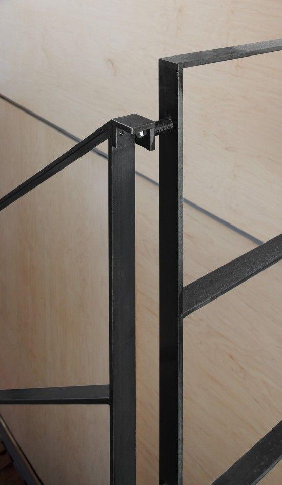 Maison E3 by Natalie Dionne Architecte. Black handrail and horizontal balustrade