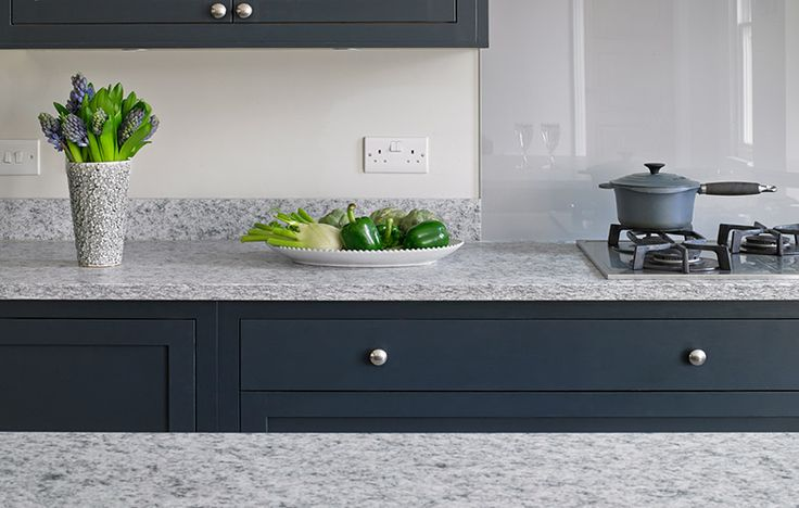 Esher Kitchen granite worktops with navy blue cabinets