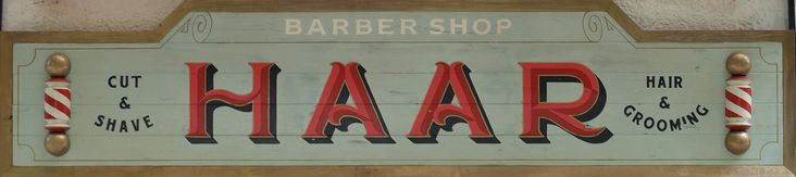 Signboard from oak, for an old-fashioned barber shop.
