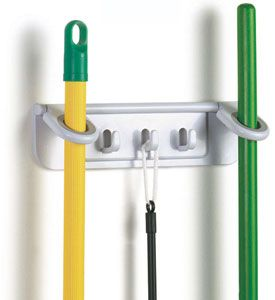 The Mounted Mop and Broom Organizer offers a pair of storage rings to hold mop and broom handles and three storage hooks for hanging additional cleaning tools. The broom and mop holder is made in the USA with ABS plastic includes a pair of screws and adhesive pads for mounting and features textured rubber gaskets insid