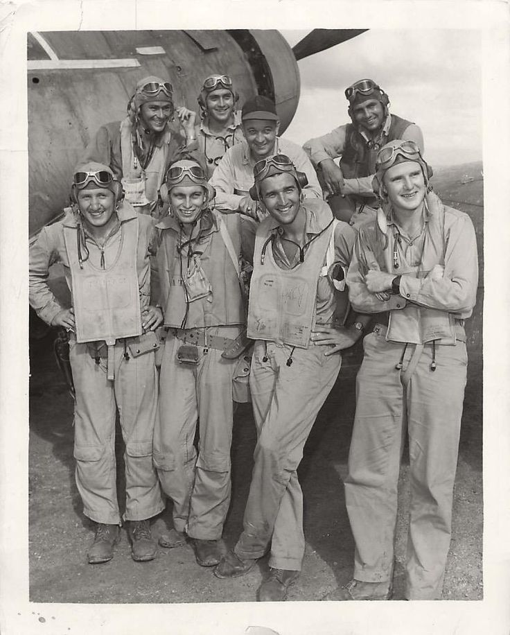 """1944- U.S. Marine fighter pilots of VMF-214 the """"Black Sheep Squadron"""". Back, left to right: John F. Bolt, Don J. Fisher, James M. Reames and Denmak Groover. Front: Burney L. Tucker, Rufus Chatham, Harry C. Johnson and Gelon H. Doswell."""