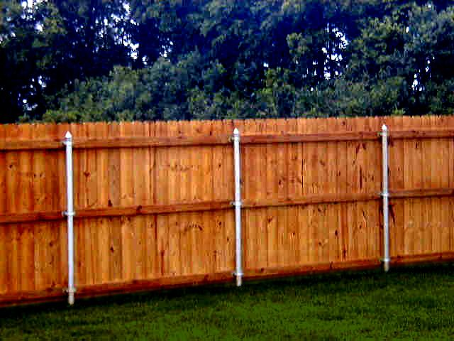 Metal posts, wood fence, great way to secure it and make it last alot longer.