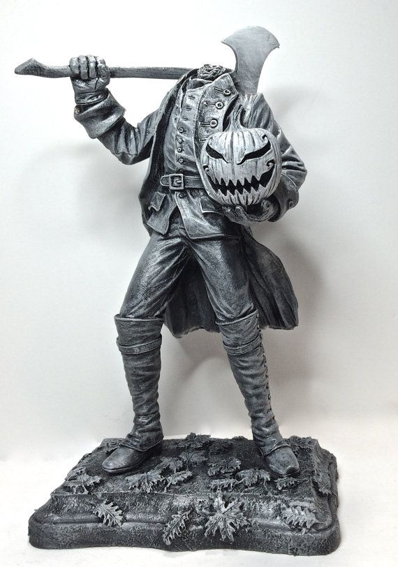 "Headless Horseman Statue  $60.00  Sculpture of the Headless Horseman, based on the Legend of Sleepy Hollow by Washington Irving. Dressed in a Hessian uniform and wielding an axe, he can either carry the Jack O' Lantern in his hand, or it can be placed on his shoulders.  Statue stands 10"" tall, cast in resin and hand painted"