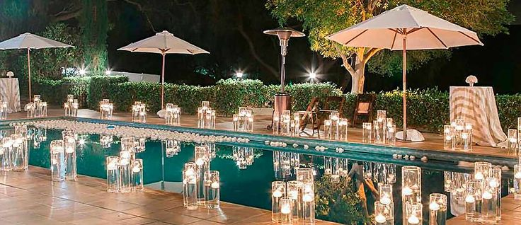 There are modern methods to decorate pool. The most inexpensive is floating candles and flowers. See our collection of wedding pool party decoration ideas!