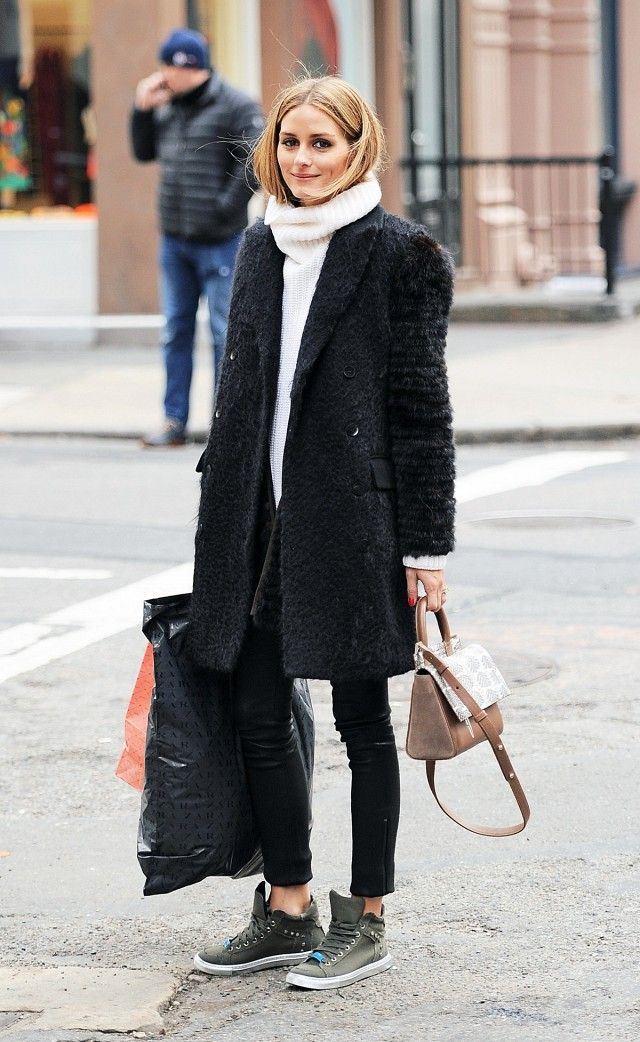 Olivia Palermo wears a turtleneck sweater, textured coat, skinny pants, high-top sneakers, and a top-handle bag