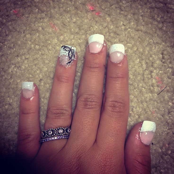 French tip nail with design on ring finger