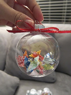 Jodi, I have some of these glass ornaments, I am going to get paper scraps from your Bridal Shower and Wedding Presents and make you them. Instead of that ugly bow I am going to put a tag with your wedding date and names. You can thank me later. ;-)  paper crane ornament - so pretty! So we can always remember our engagement :)