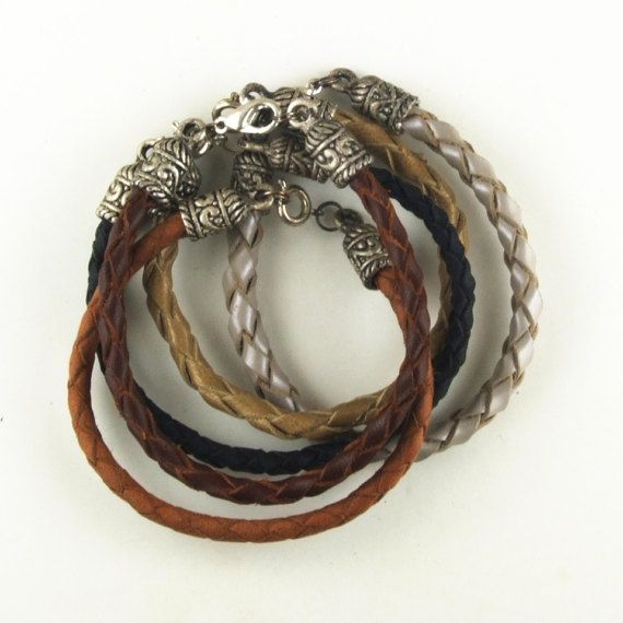 Braided leather bracelets 4 strand with ornate metal caps and