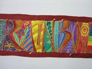 """Silks and Art by Jill - """"Rainbow"""" written along silk scarf"""
